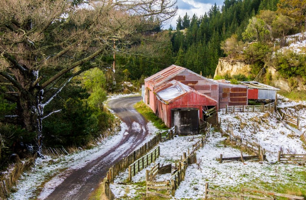 This is also high in the Rangitikei Hill Country, an old woolshed looking cool ij the snowy morning sun