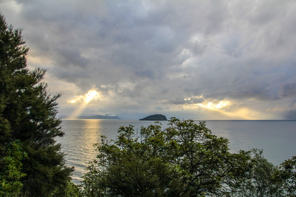 Rays punching through the clouds above Lake Taupo.