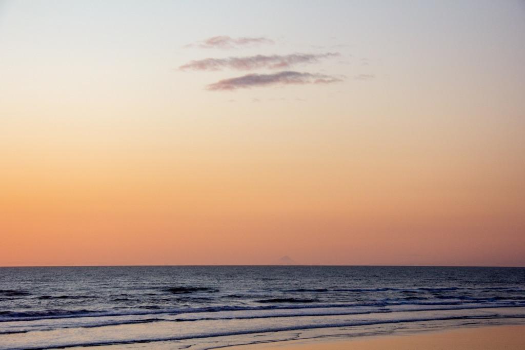On the horizon, in the distance is Mt Taranaki, 210 Kilometres distant