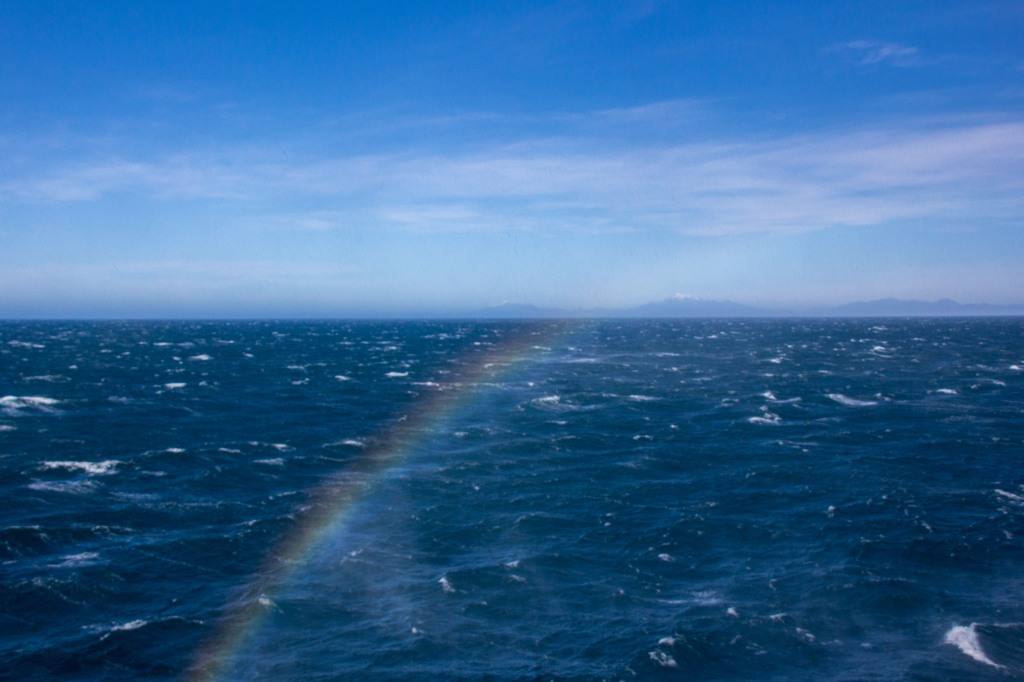 On a rough crossing in Cook Strait, the large bit of water between the North and South Island's you sometimes get these sea spray 'rainbows'. You have to be quick to photograph them as they come and go. Plus you risk a salt water soaking of your camera. You decide if it's worth it.
