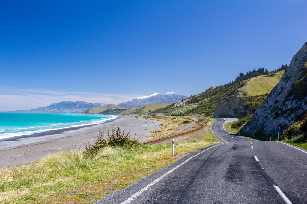 That's New Zealand's main road. State Highway One. The rail line beside it is the main rail route south. This is how we get about. It's nice here.