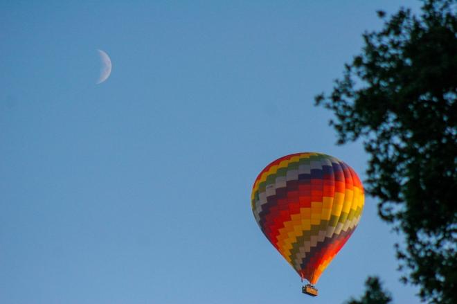 The moon and a balloon. Surrey, England